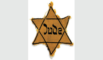 A yellow star of David marked with the German word for Jew (Jude).